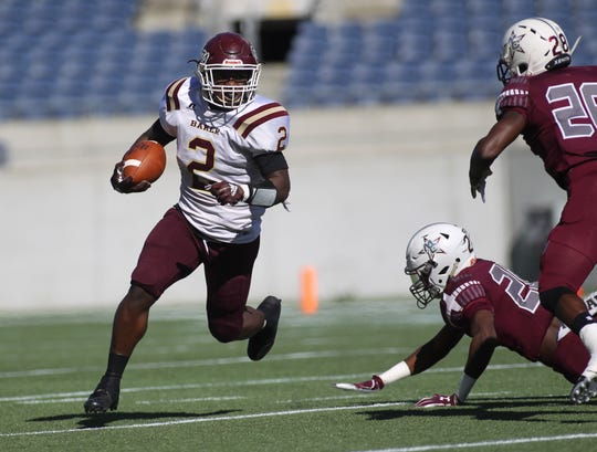 Baker running back Junior McLaughlin runs for a gain during the first quarter of Madison County's 48-6 win over Baker in a Class 1A state championship game on Thursday at Orlando's Camping World Stadium.
