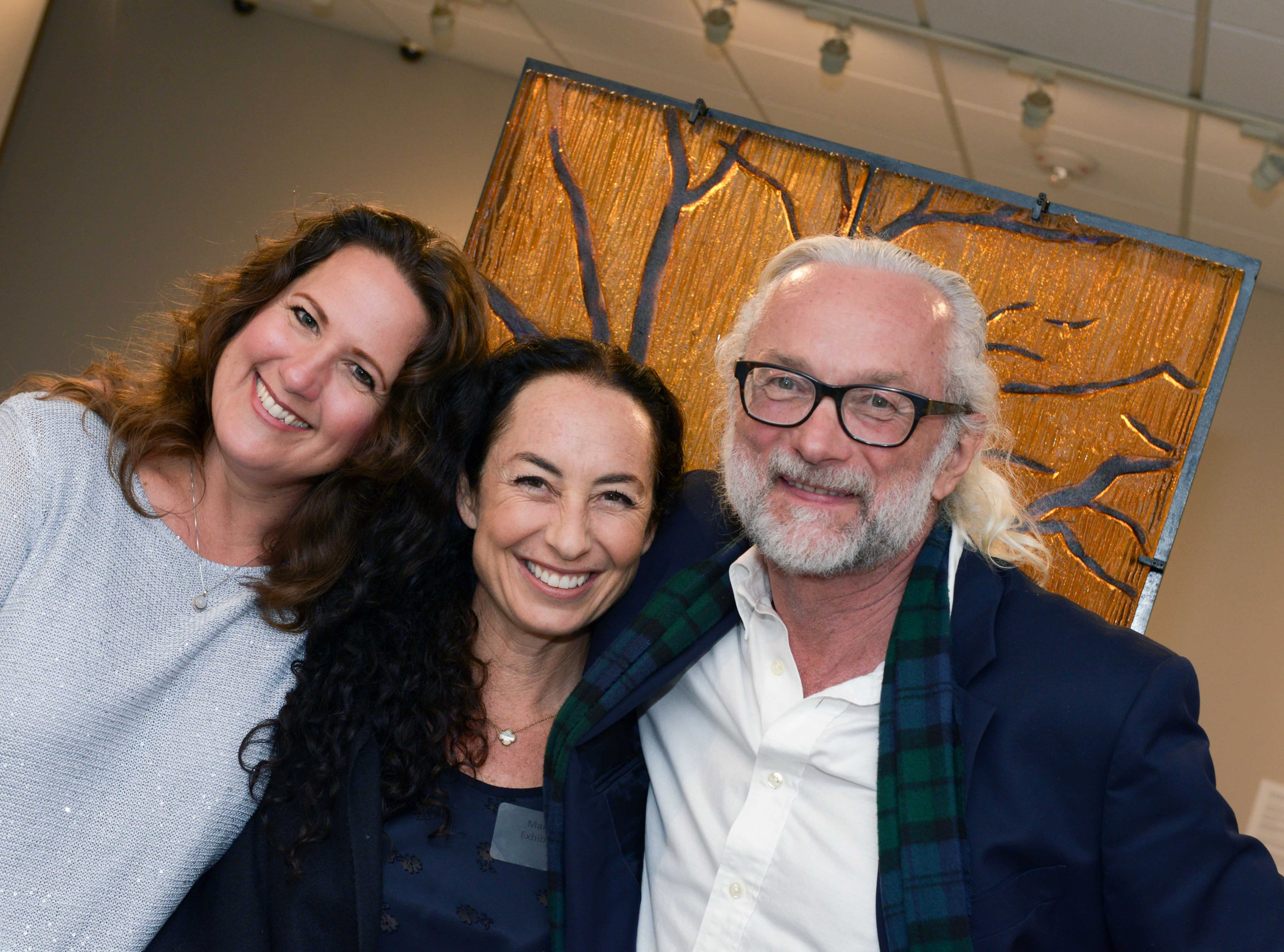 "Carrie Adams, left, with artist Marlene Rose and Thomas Coates at the A.E. Backus Museum's ""Masters of Glass: Dale Chihuly and Marlene Rose"" exhibit."