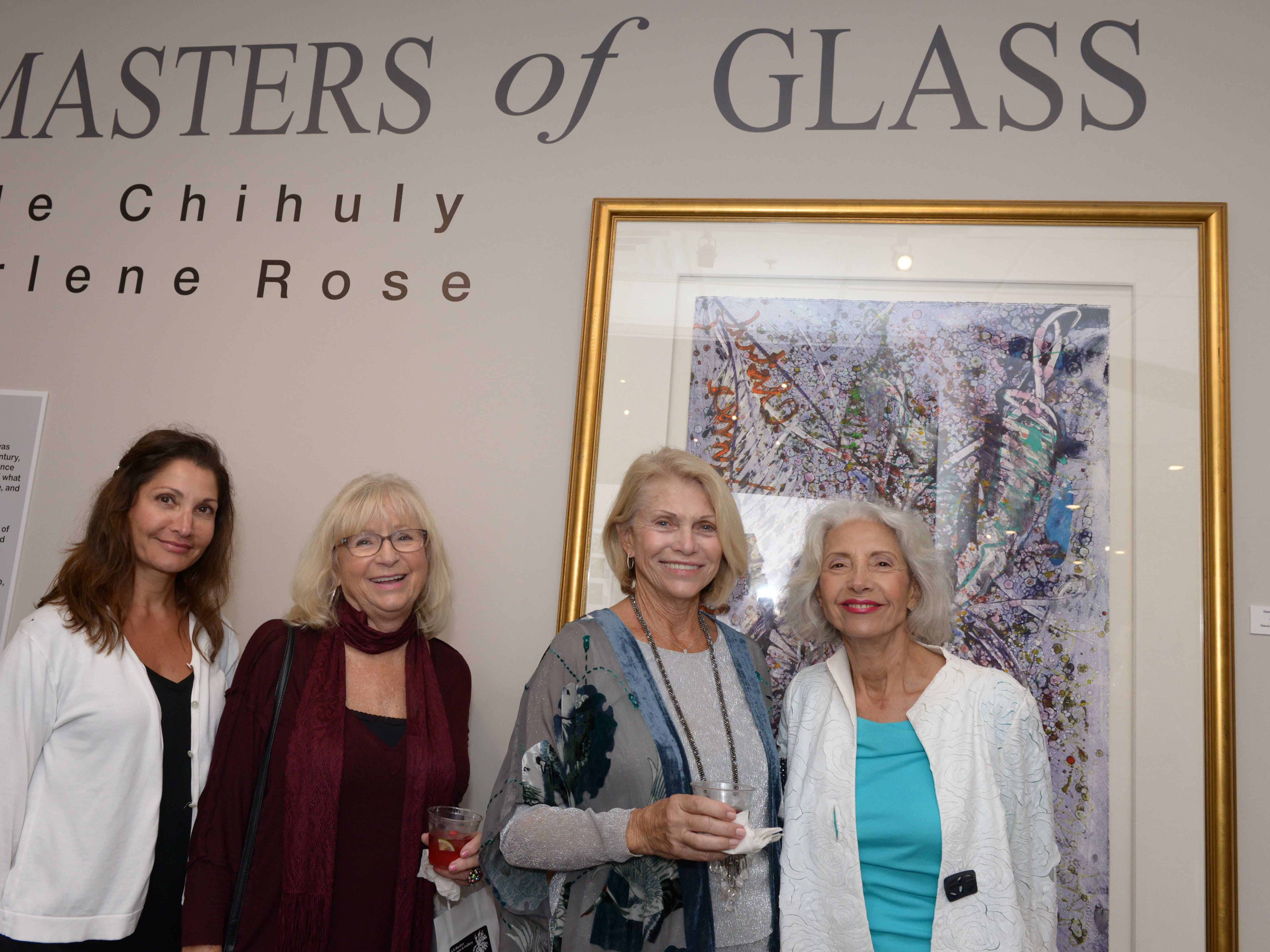 "Dorian DeFrancesco, left, Ursula Busch, Elizabeth Borelli and Louise Teising at the A.E. Backus Museum's ""Masters of Glass: Dale Chihuly and Marlene Rose"" exhibit."