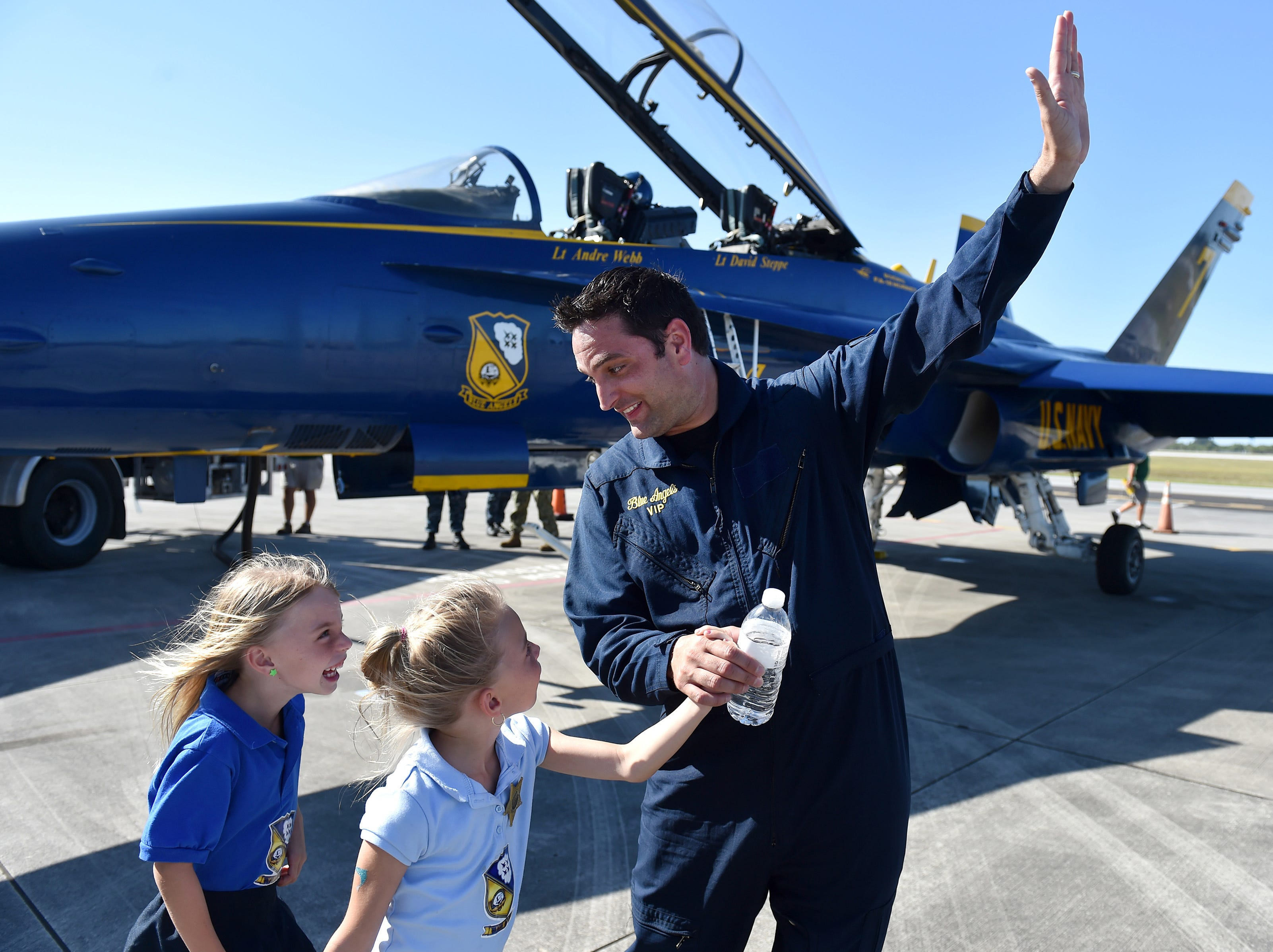 """""""Did you see the airplane when it was going up like this,"""" said TCPalm editor Adam Neal, to his twin daughters Kaley (left), and Ryley, 6, after taking a media flight in a Blue Angels F/A-18 Hornet aircraft Wednesday, April, 18, 2018, at the Vero Beach Regional Airport in Vero Beach. The Blue Angels performed at the 2018 Vero Beach Air Show that weekend."""