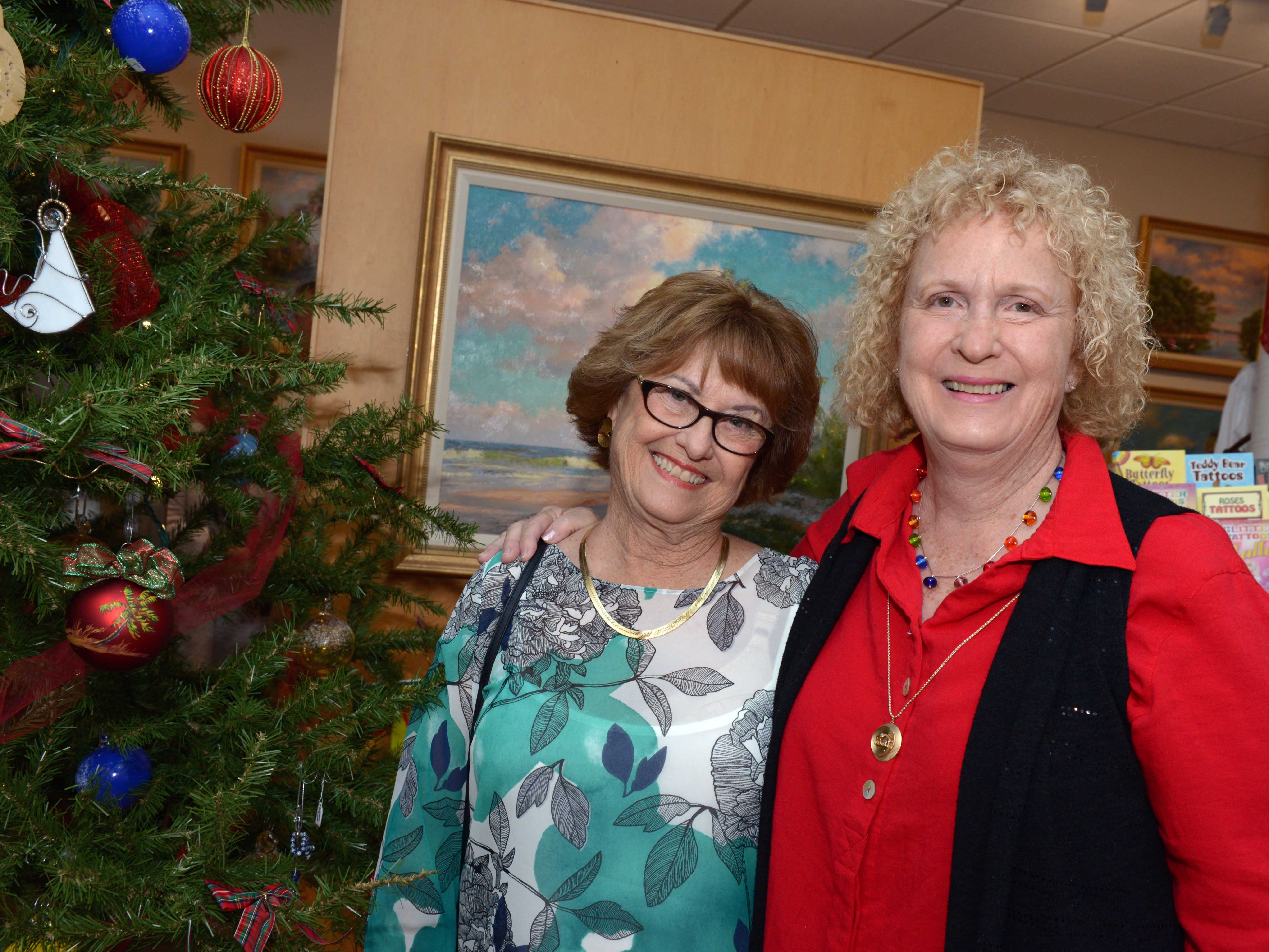 "Jackie Schindehette, left, and Mimi Brown at the A.E. Backus Museum's ""Masters of Glass: Dale Chihuly and Marlene Rose"" exhibit, on display through Dec. 30."