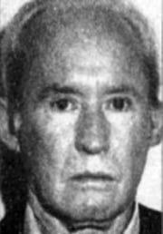 Mugshot of Tucker in the 1980s.