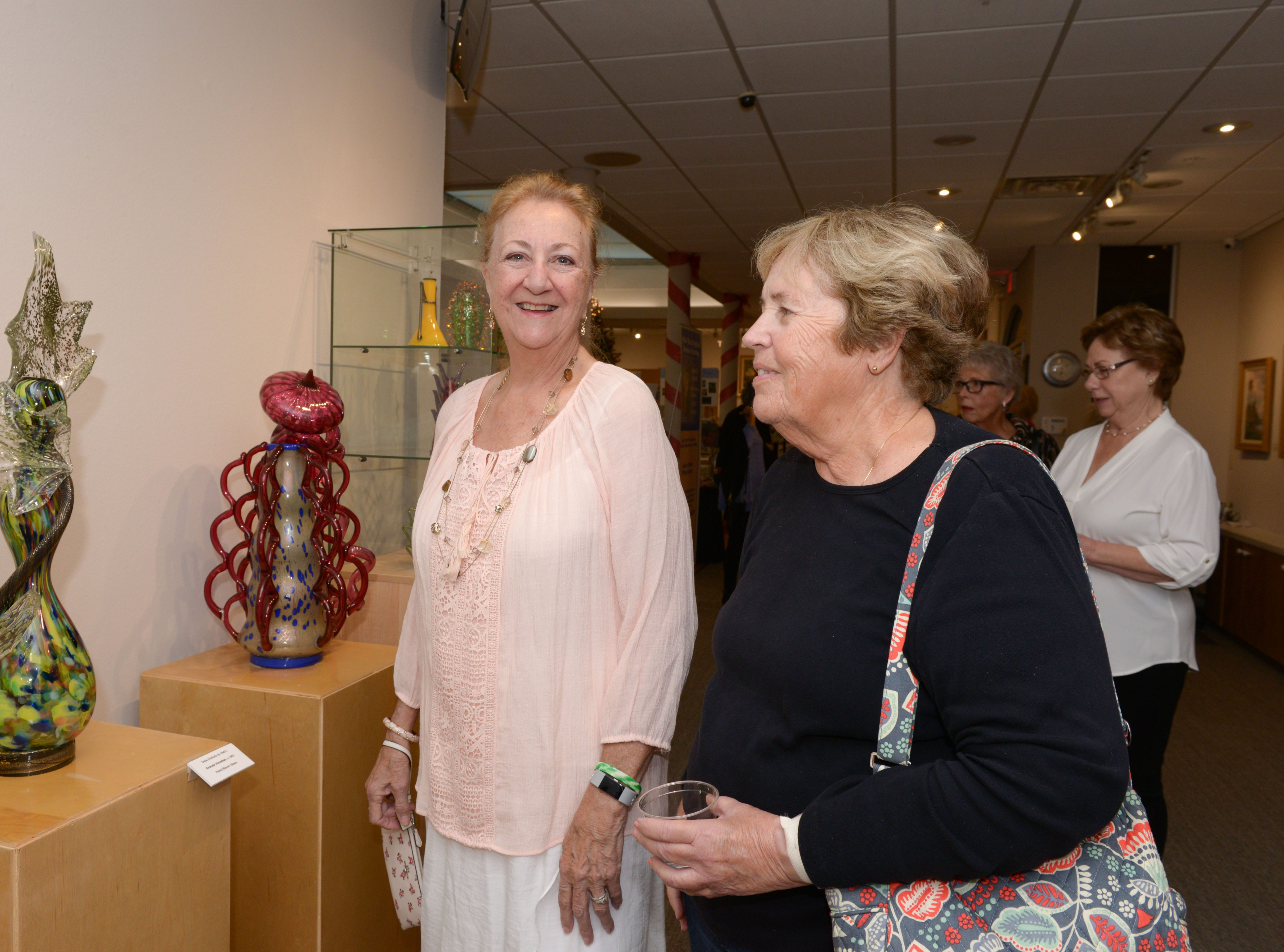"Joyce Thomas and Alicemarie Donohue at the A.E. Backus Museum's ""Masters of Glass: Dale Chihuly and Marlene Rose"" exhibit."