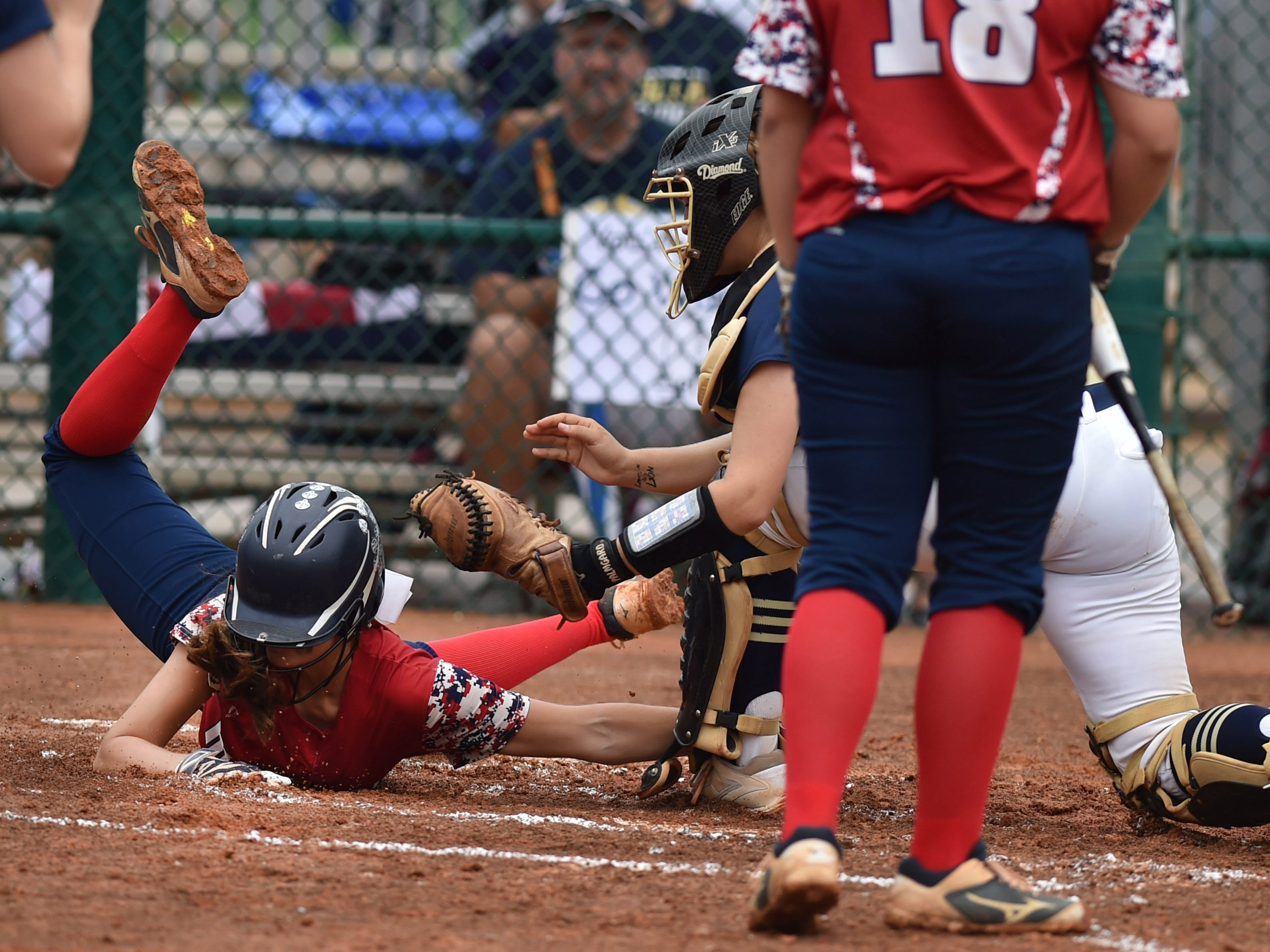 Halle Morgan, of Masers Academy, is tagged out by Kaylie Rogers, catcher for Aucilla Christian, while trying to steal home in the top of the third inning of their Class 2A state semifinal game at Historic Dodgertown on Monday, May 21, 2018, in Vero Beach.