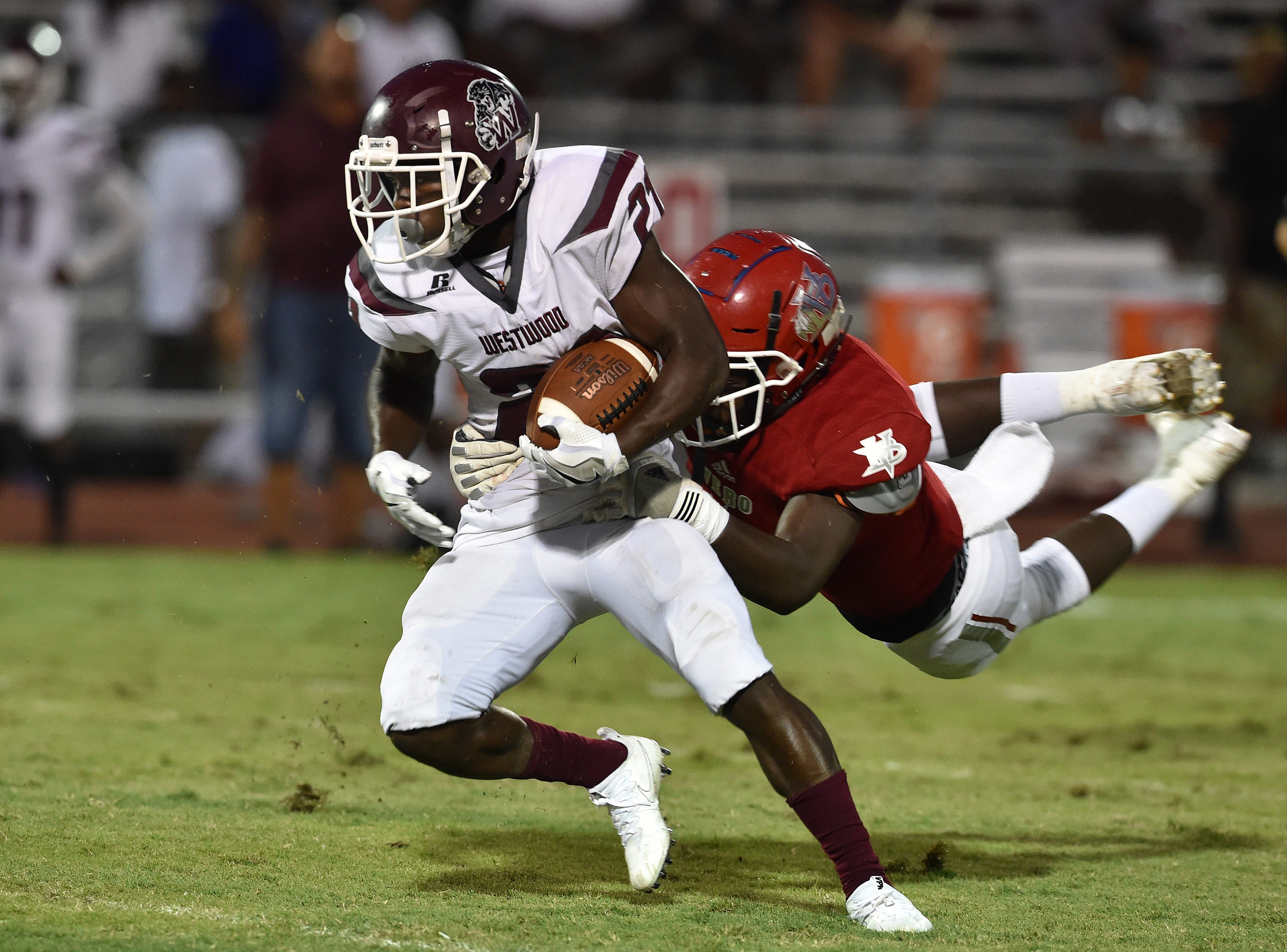 Fort Pierce Westwood's Jenard Jones is slowed by the grip from Corey Henry, of Vero Beach, before being tacked for a loss on the first quarter play on Friday, Oct. 5, 2018, at the Citrus Bowl in Vero Beach.