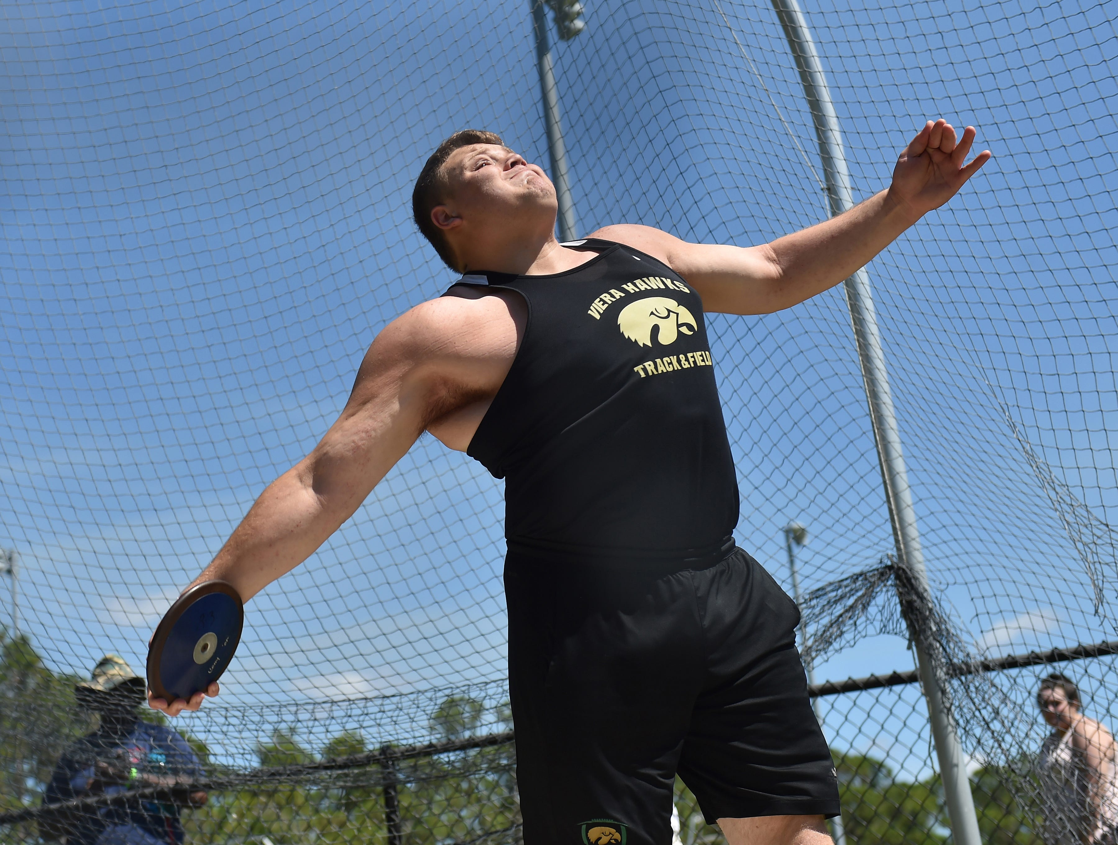 Giovanni Allen, of Viera High School competes in the Boy's Discus preliminary round with a distance of 32.91 feet during the Region 4-3A Track and Field Meet at South Fork High School on Thursday, April 26, 2018, in Stuart.