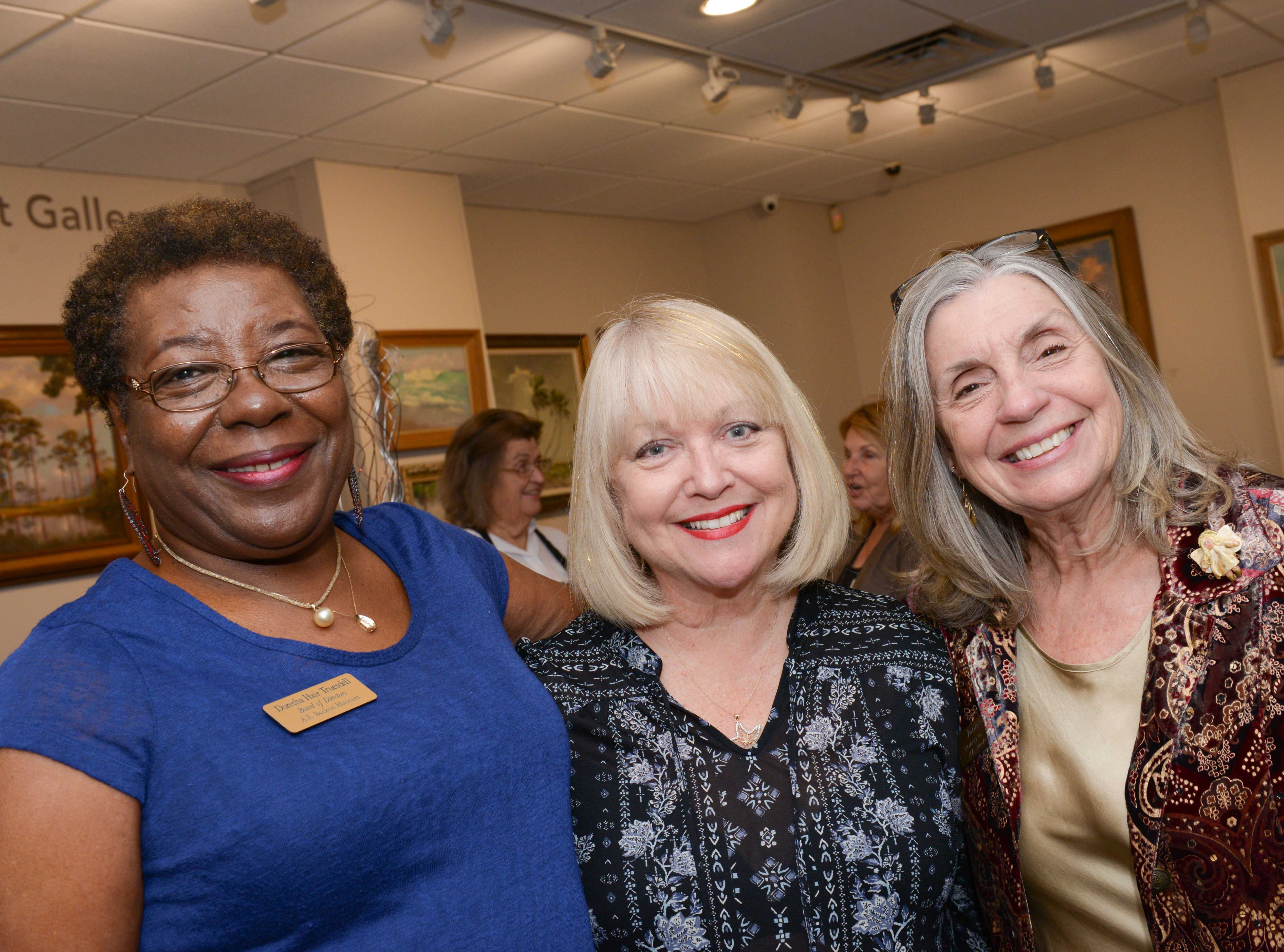 "Doretha Hair Truesdell, left, Sydney Liebman and Board President Janie Hinkle attend the A.E. Backus Museum's ""Masters of Glass: Dale Chihuly and Marlene Rose"" opening reception."