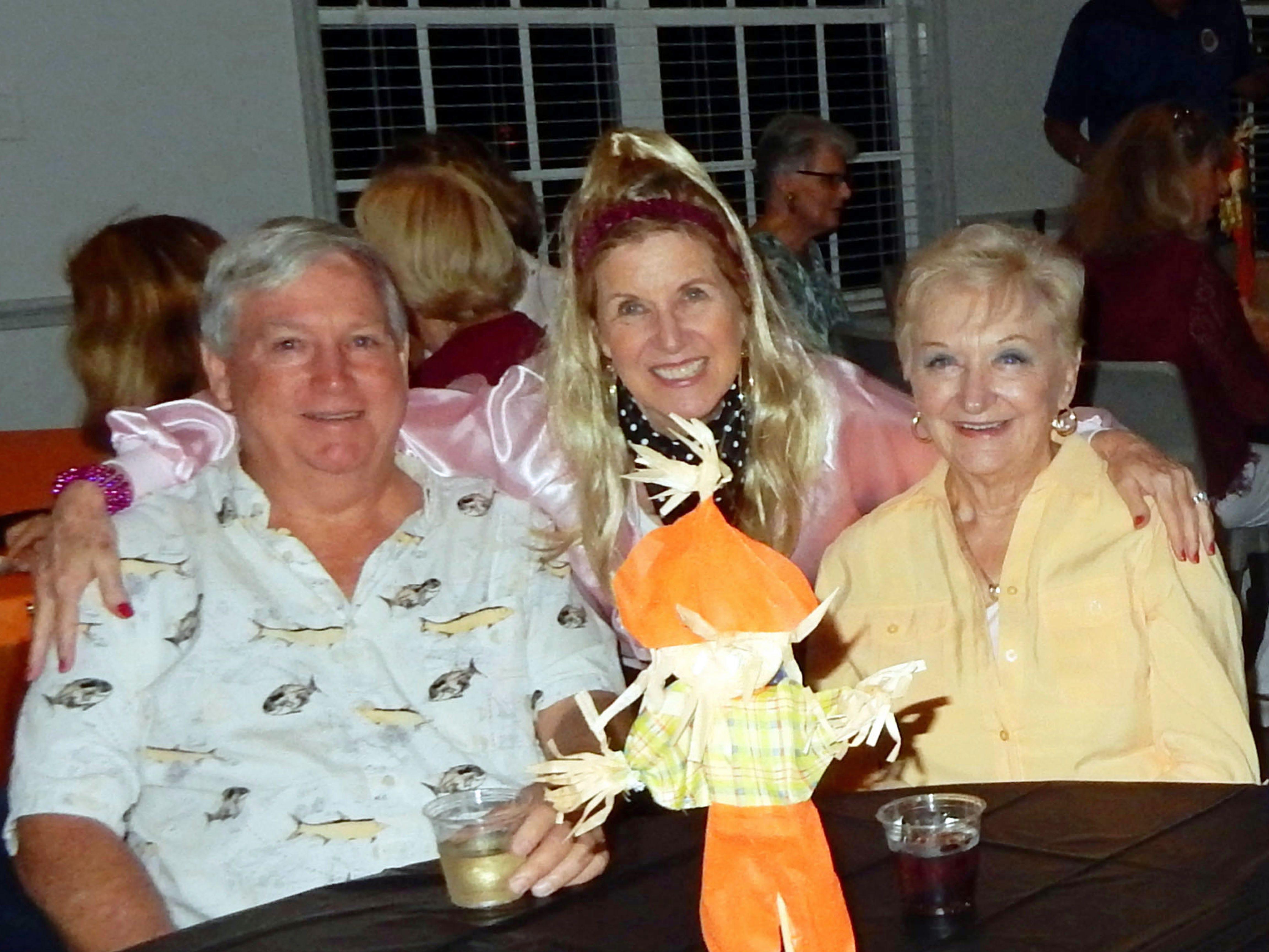 Ken Walker, left, Diana Walker and Evie Aiken at the Exchange Clubs Halloween Party.