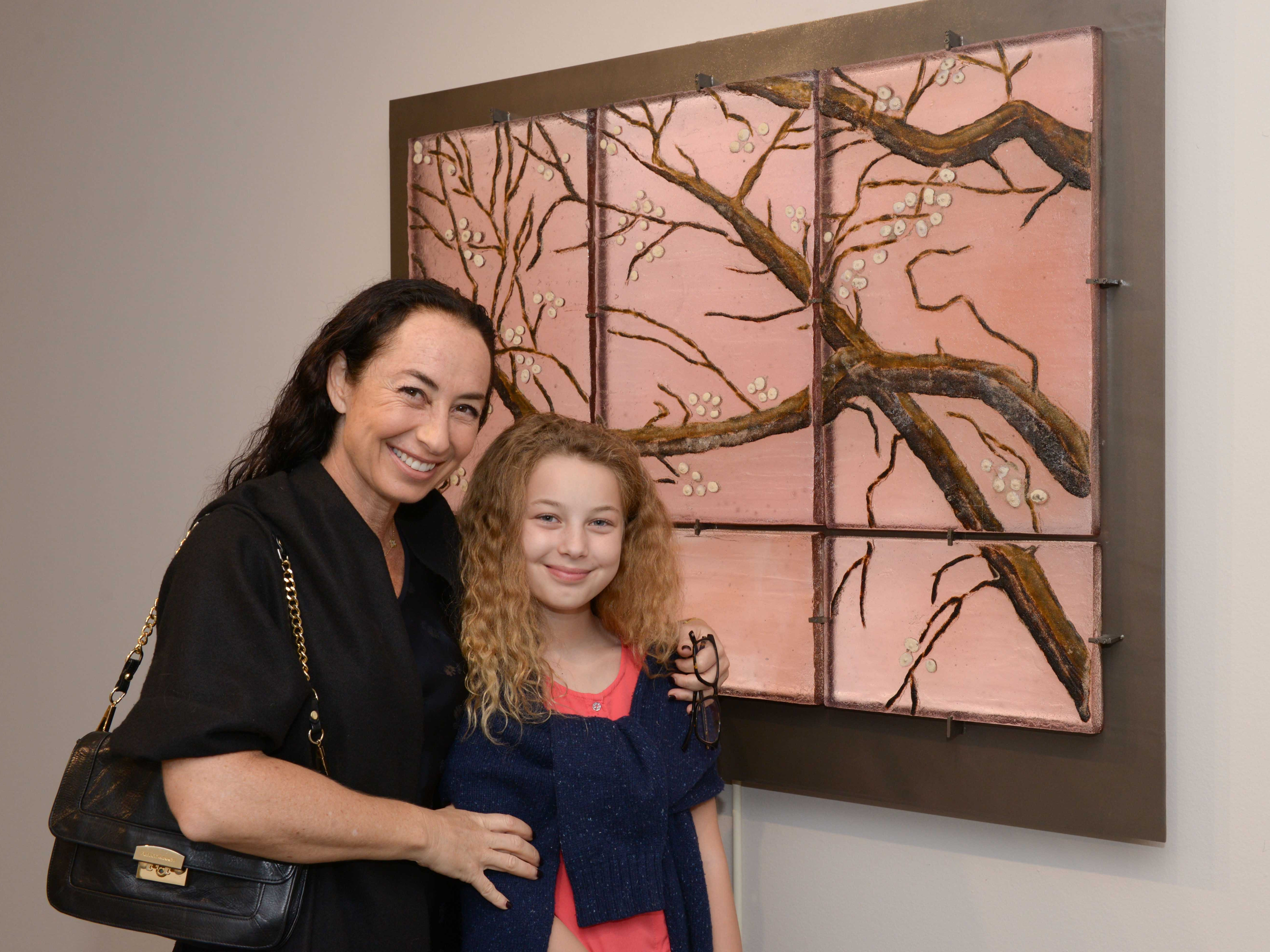 "Exhibiting artist Marlene Rose and Lucia Rose-Coats in front of ""Rose Cherry Blossom"" at the A.E. Backus Museum in Fort Pierce."