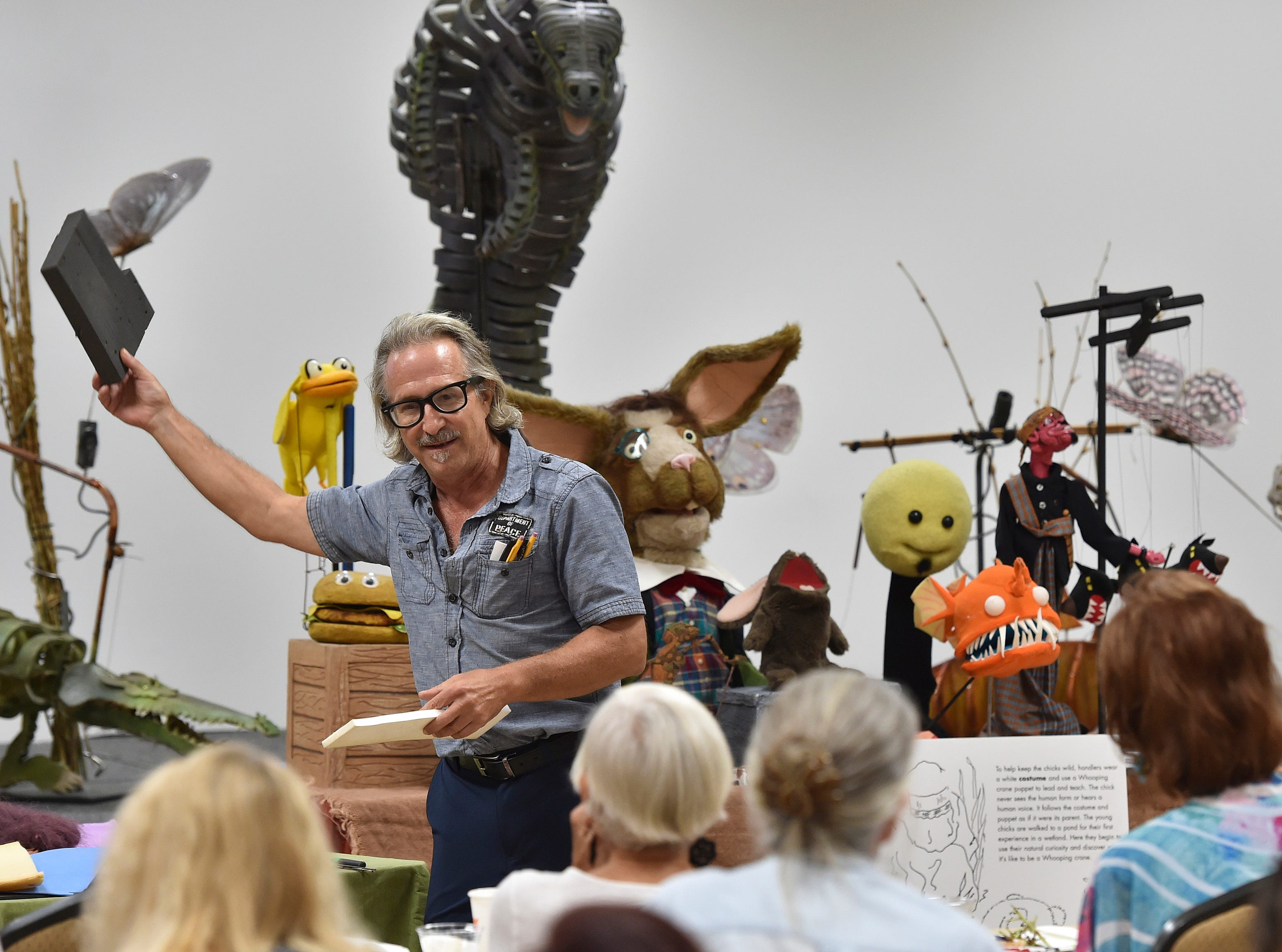 """David Jordan, of Ibex Puppetry of Orlando, holds up a block of microcell foam while describing materials he uses to manufacture puppets during a puppetry class educators and artists on the history of puppetry and how it can be used in education on Thursday, Sept. 13, 2018, at the Havert L. Fenn Center in Fort Pierce. """"It's a blessing to be able to do puppetry, it's a great art form,"""" Jordan said. """"It's such a broad deep well of exploration, materials, subjects, all of them."""""""