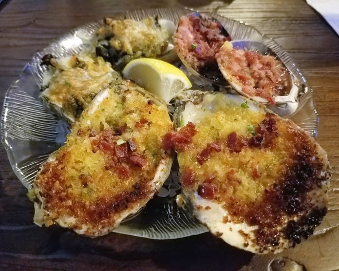 Johnny's Half Shell's hot mix was two Oysters Rockefeller, two char-grilled oysters and two Clams Casino served on a bed of rock salt.
