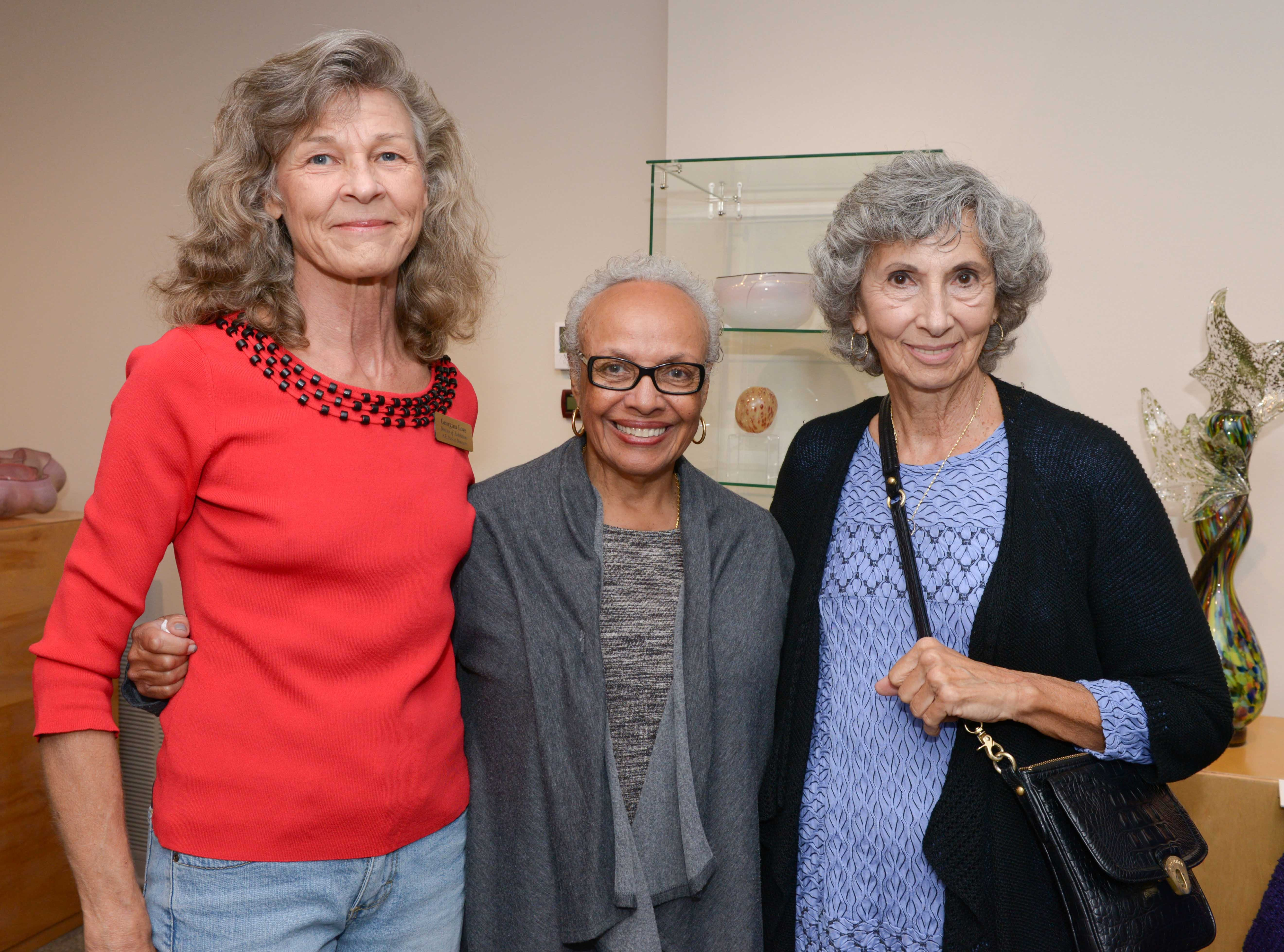 """Georgina Love, left, Bunny Webb and Carolyn Luxion at the A.E. Backus Museum's """"Masters of Glass: Dale Chihuly and Marlene Rose"""" exhibit, on display through Dec.30."""