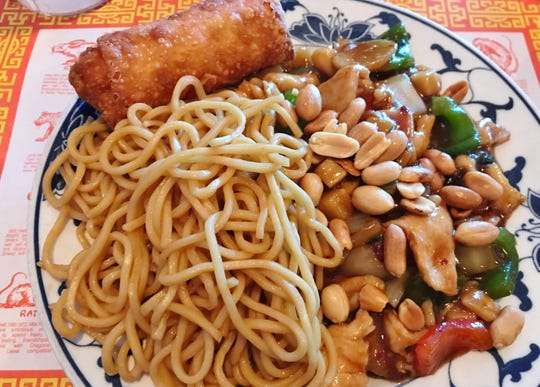 China Delight's  Kung Pao Chicken with marinated chicken, chunks of peppers and a scattering of peanuts in a sauce that went perfectly with the Lo Mein noodles on the side. The deep-fried egg roll was filled with ground pork and cabbage and seasoned with Chinese Five Spice.