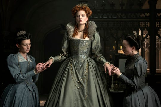 "This image released by Focus Features shows, from left, Grace Molony as Dorothy Stafford, Margot Robbie as Queen Elizabeth I and Georgia Burnell as Kate Carey in a scene from ""Mary Queen of Scots."""