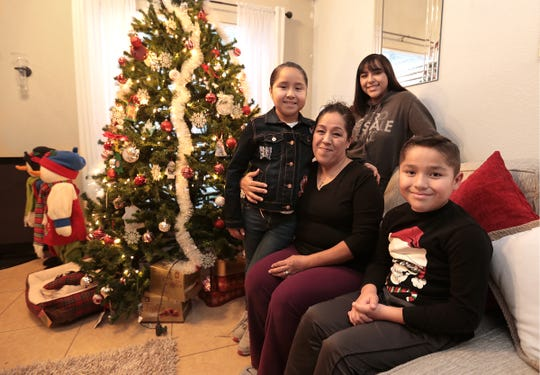 Claudia Rosales is shown with her children Jacqueline Rosales, 11, left, Marco Rosales, 9, and Wendy Moreno, 19.