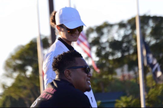 Mikala Cvijanovich, 21, the strength and mobility coach for the Ventura College football team, watches a recent practice with assistant coach Tiai Salanoa.