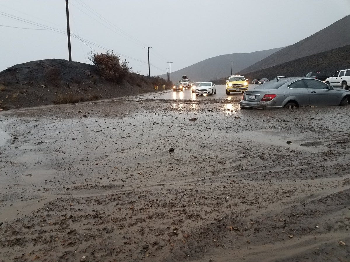 Mud flooded across a portion of Pacific Coast Highway Thursday morning, closing the road to traffic for several hours.