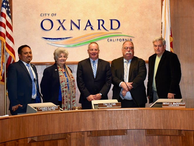 The Oxnard City Council pose for a photo on Dec. 4, 2018, during the last meeting in which the council consists of five members. Starting Dec. 11, the council will have seven members.