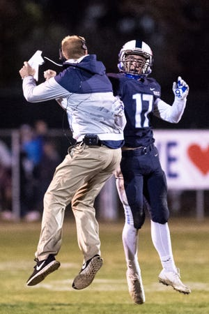 Central Valley Christian head coach Mason Hughes celebrates with Brendon Atsma after a play against Morse in a CIF SoCal Regional Championship Bowl Game on Friday, November 30, 2018.