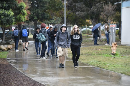 Students at University Prep High School walk class on Thursday morning. On Wednesday, a science teacher was arrested after she was recorded cutting a student's hair.
