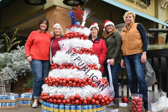 Volunteers construct a forest of 'can food trees' to benefit Foodlink and Tulare County's hungry.