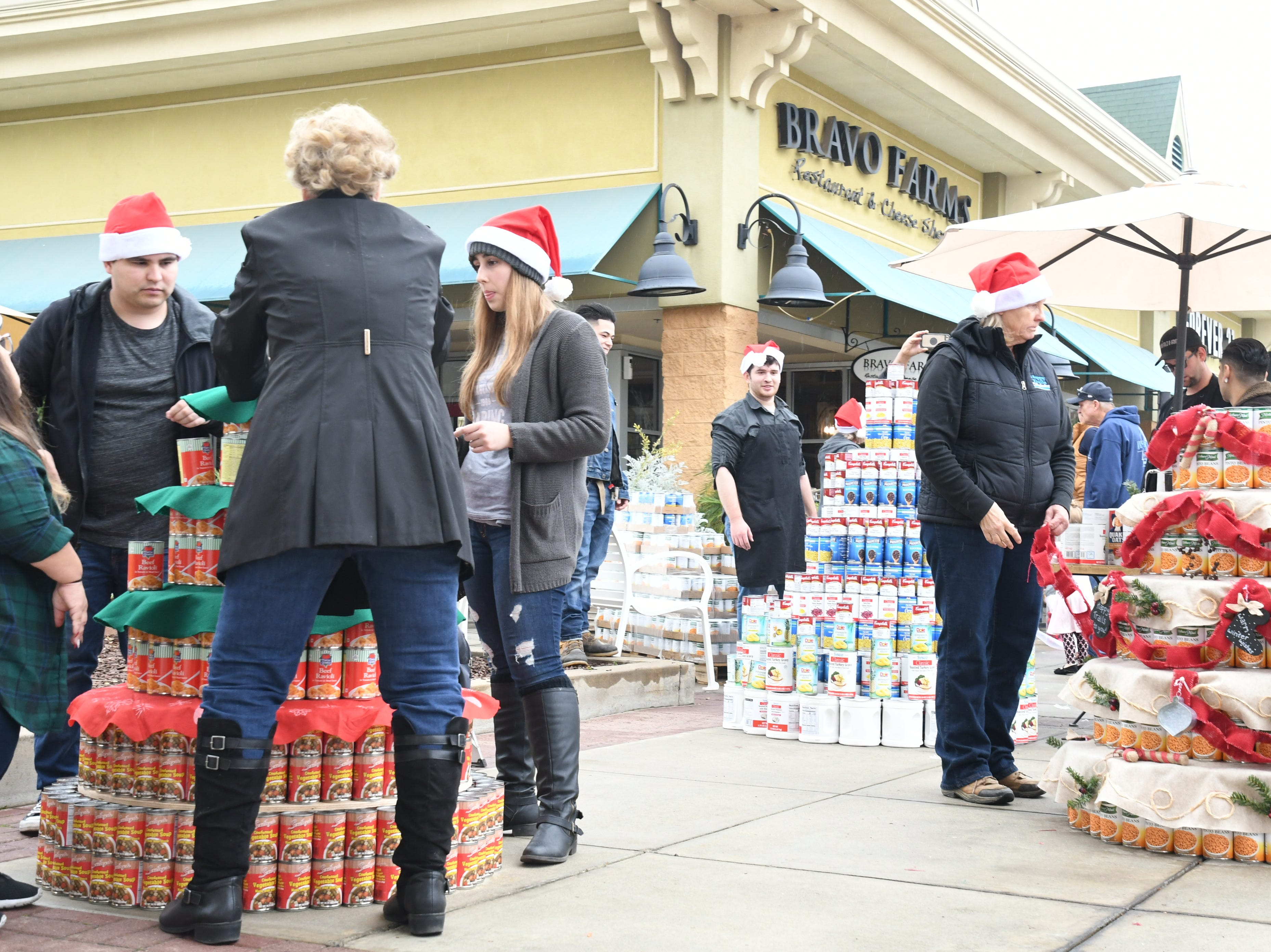 'Can food tree' forest comes to Tulare Outlets, 30,000 cans raised for Foodlink