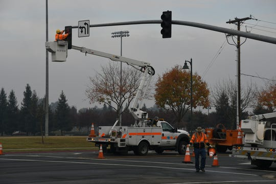 Cal-Trans repairs traffic lights on N Dinuba Boulevard and Shannon Parkway after an 18-year-old man struck the pole and died early this morning.