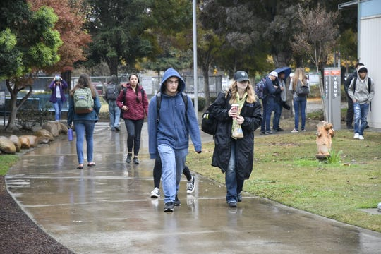 Students at University Prep High School walk to class on Thursday, December 6, 2018. On Wednesday, a science teacher was arrested after she was recorded cutting a student's hair.