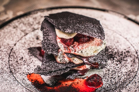 Eton Mess at The Rare Bit in Dobbs Ferry. Chef Dave DiBari has altered the traditional English dessert by adding charcoal meringue and absinthe-soaked strawberries.