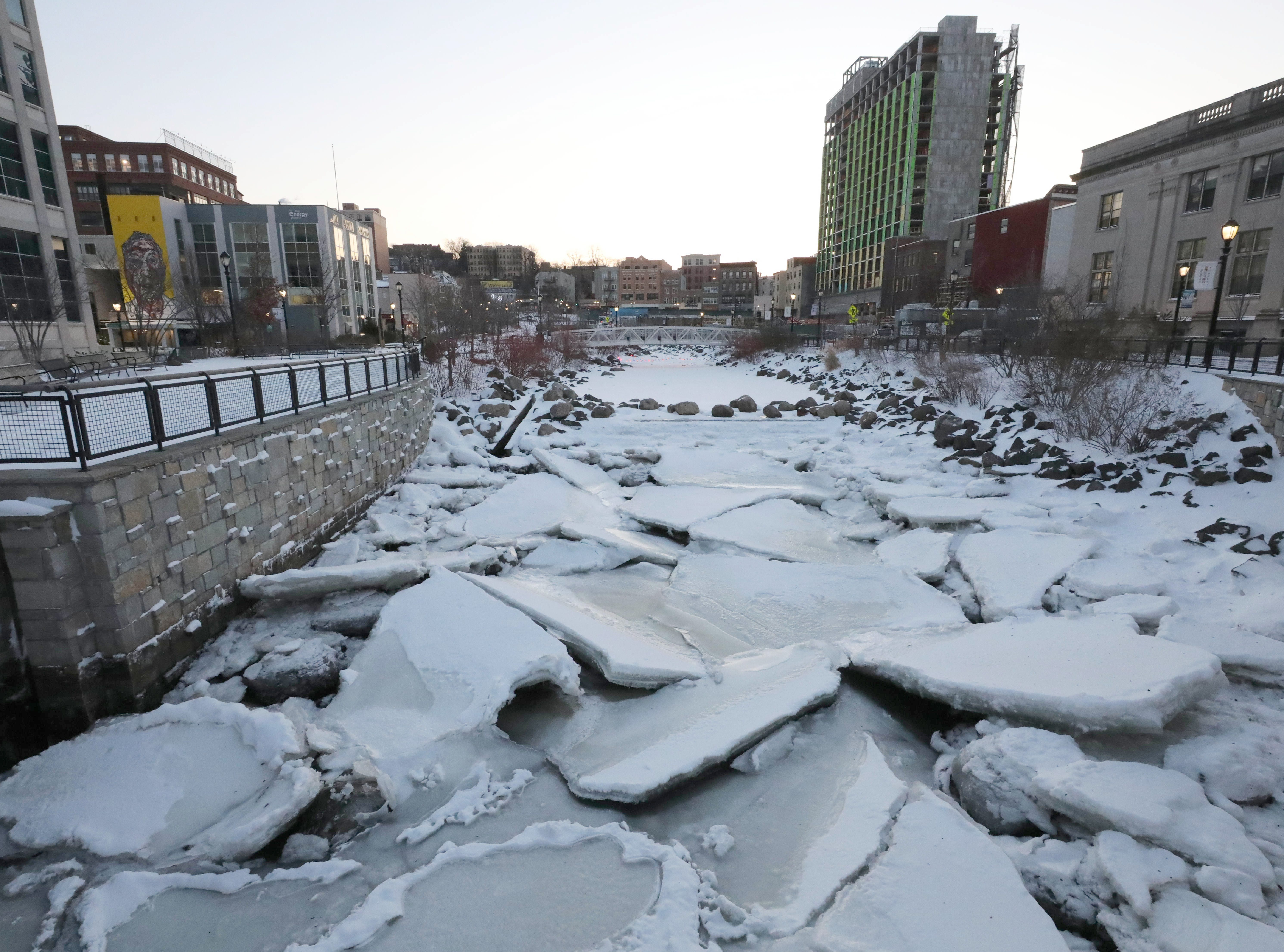 Ice plates jut out of the frozen Saw Mill River at Van der Donck Park in downtown Yonkers, Jan. 5, 2018.  The water from the river leads to the nearby Hudson River.