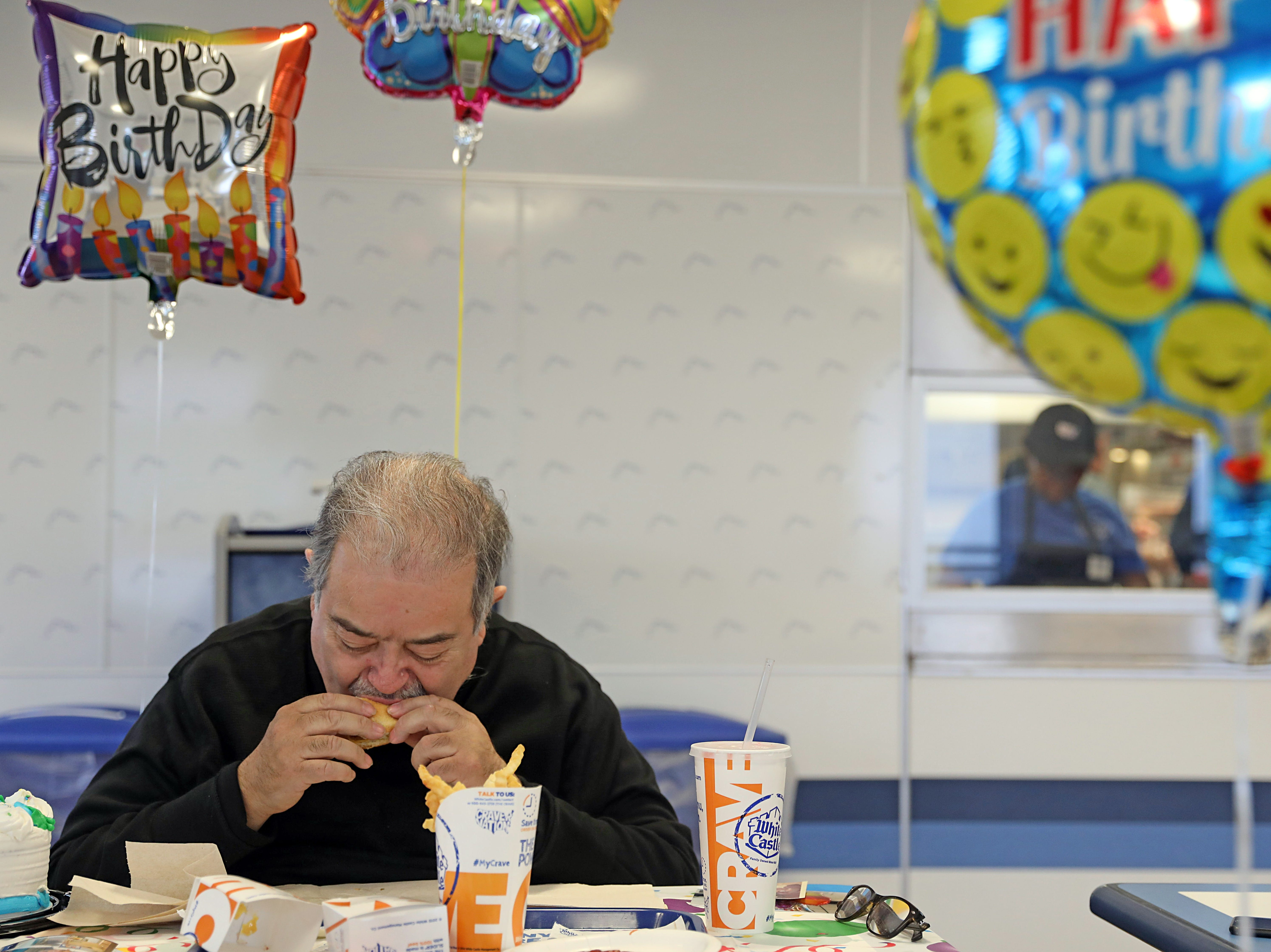Peter Bevilacqua eats a fish sandwich on his 62nd birthday at White Castle in Nanuet April 3, 2018. Bevilacqua has been going to White Castle on his birthday for the past 57 years.