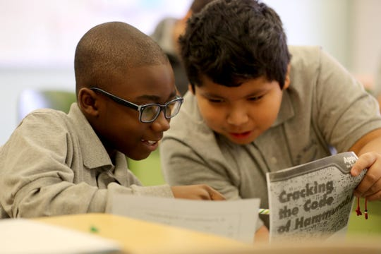 Jasiah Whitted and Jordi Morales, fifth-graders at the San Miguel Academy of Newburgh, work together during a lesson on the ancient writing system called Cuneiform Dec. 5, 2018. The San Miguel Academy, a fifth through eighth grade school, was created 12 years ago to serve low-income and at-risk youth in Newburgh. The school came to be with the help of a group of Chappaqua residents who assisted Father Mark Connell, who at the time was an assistant Pastor at Church of St Mary's in Chappaqua, in it's creation.