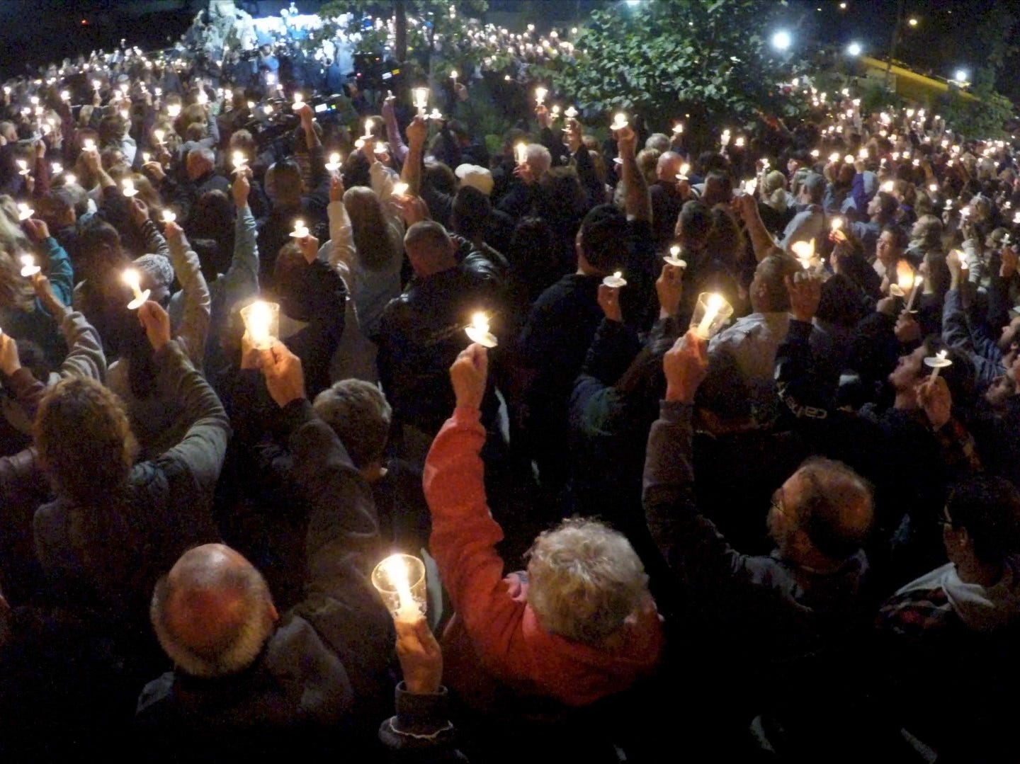 A vigil is held for the victims of the Schoharie limousine accident at the Gateway Overlook in Amsterdam, New York Oct 8, 2018