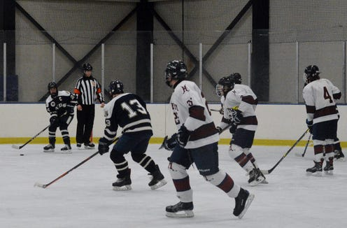 Jack Kissell (24) centers the puck to Rye Country Day teammate Josh Cohen (13) during the first period of an 8-5 win over Harvey.