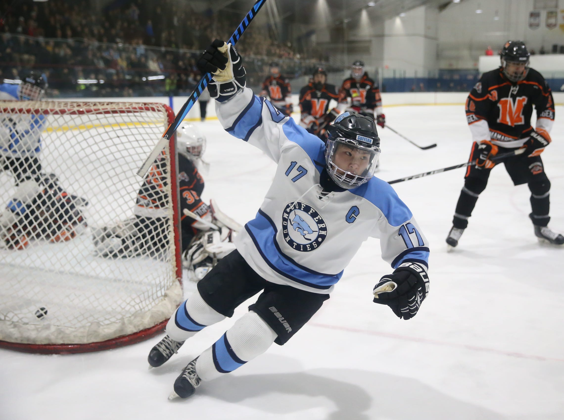 Suffern's Evan Cama (17) reacts after putting the puck past Mamaroneck goalie Jack Fried (35) in the second period of ice hockey action at Sport-O-Rama in Suffern on Friday, January 12, 2018.