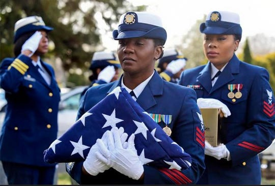 U.S. Coast Guard members participate in funeral services for Olivia Hooker Wednesday, Dec. 5, 2018, in White Plains, New York. Hooker, the first African-American woman to serve in the U.S. Coast Guard and one of the last survivors of the 1921 Tulsa, Oklahoma, race riot, has been laid to rest with military honors. Hooker, a Greenburgh, New York, resident, died on Nov. 21, 2018, at the age of 103.