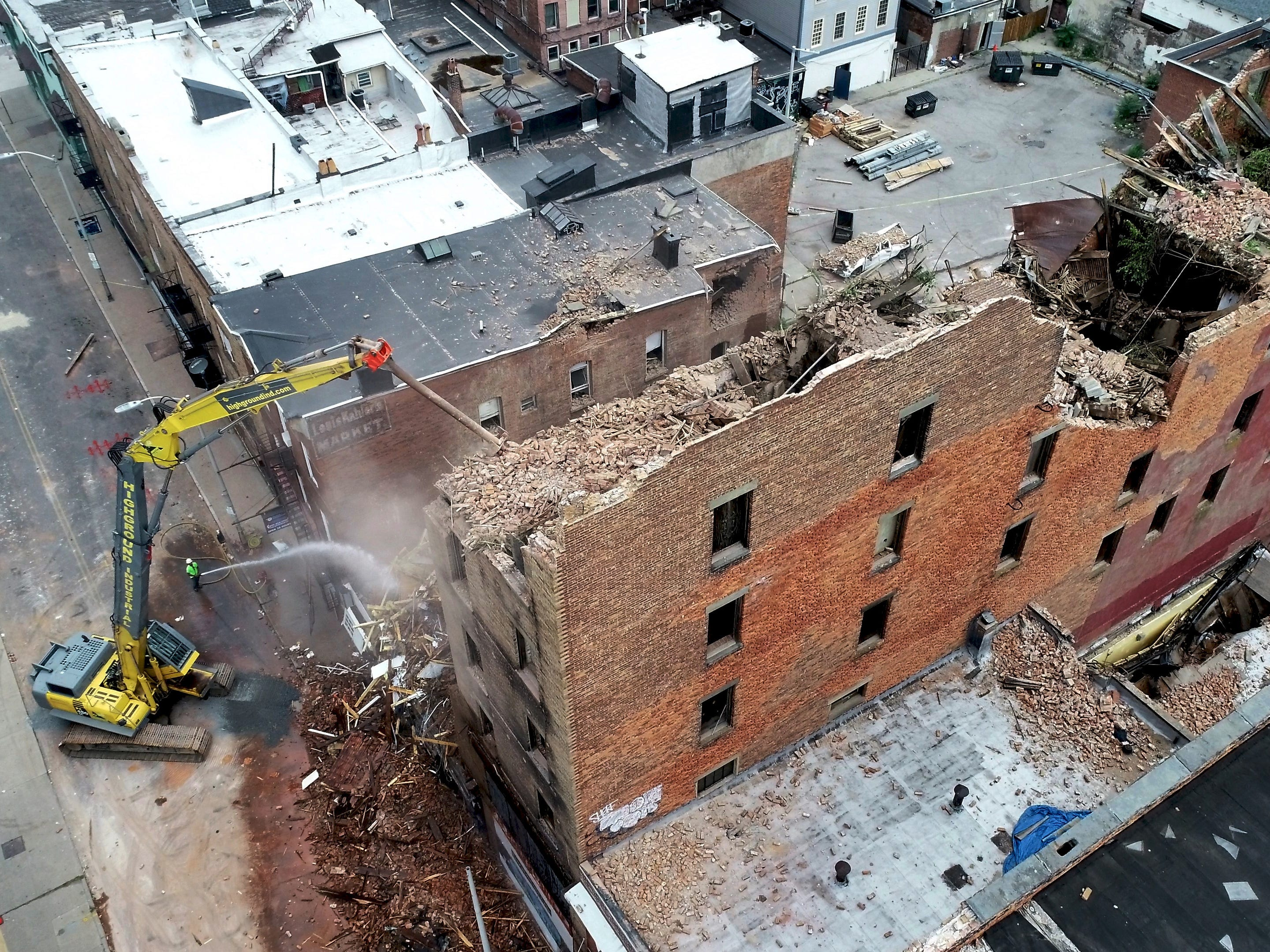 Demolition crews work to take down a collapsed building at 17 Academy St. in Poughkeepsie June 20, 2018.