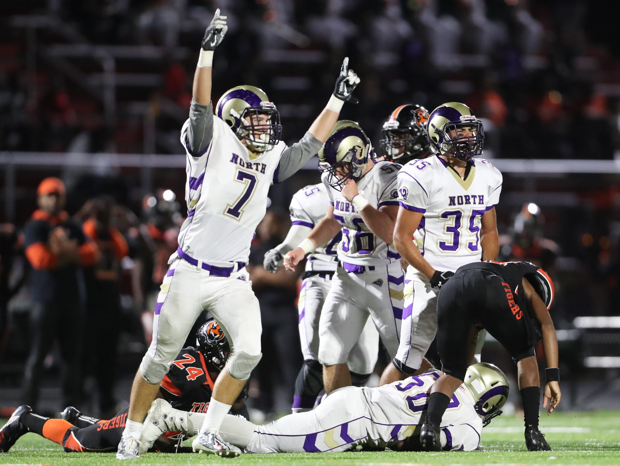 Clarkstown North's Mike McDowell (7) celebrates a fumble recovery during their 49-22 win over Spring Valley at Spring Valley High School on Friday, September 21, 2018.