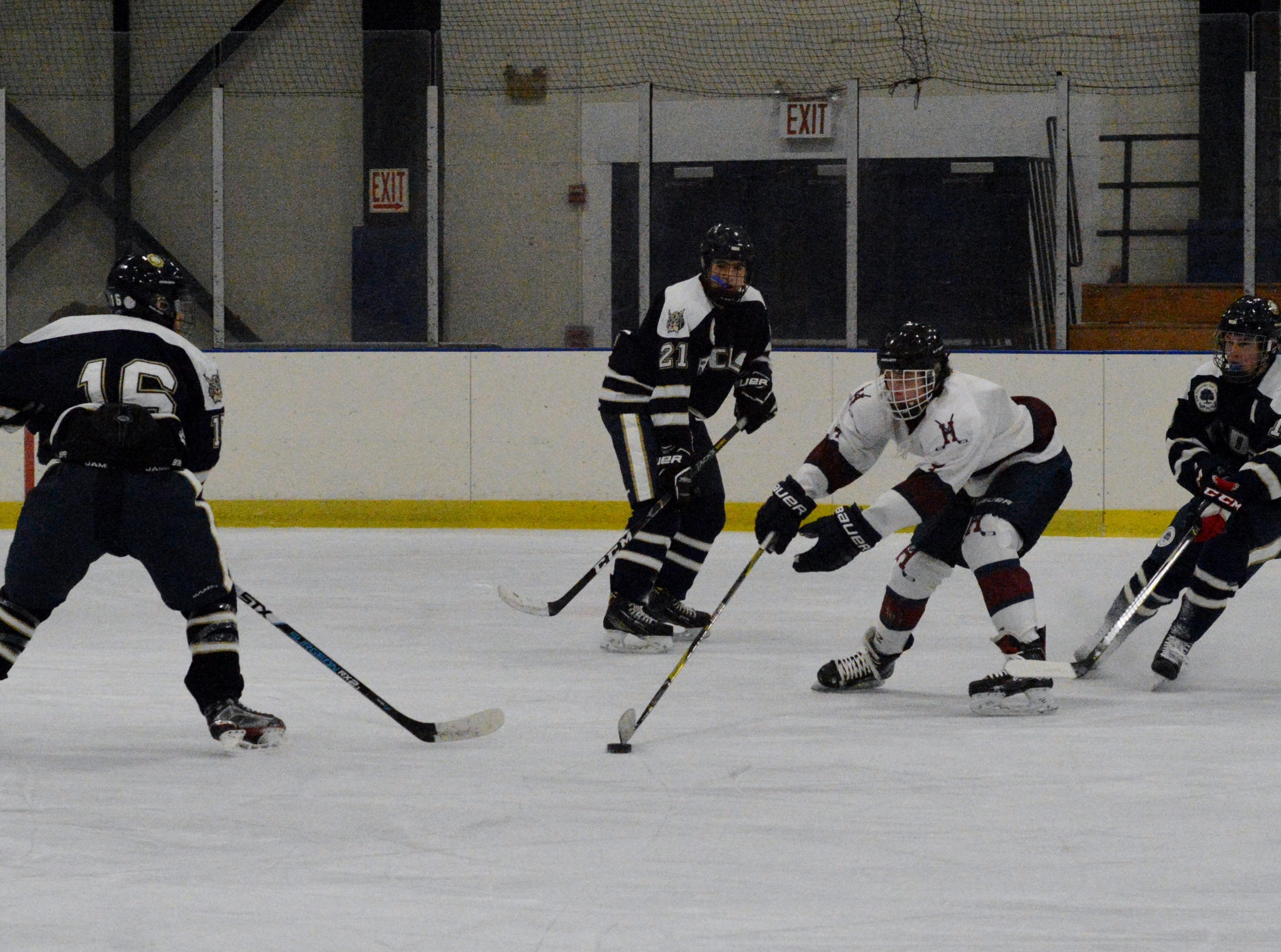 James Mettler reaches to regain control of the puck during the first period on Wednesday.
