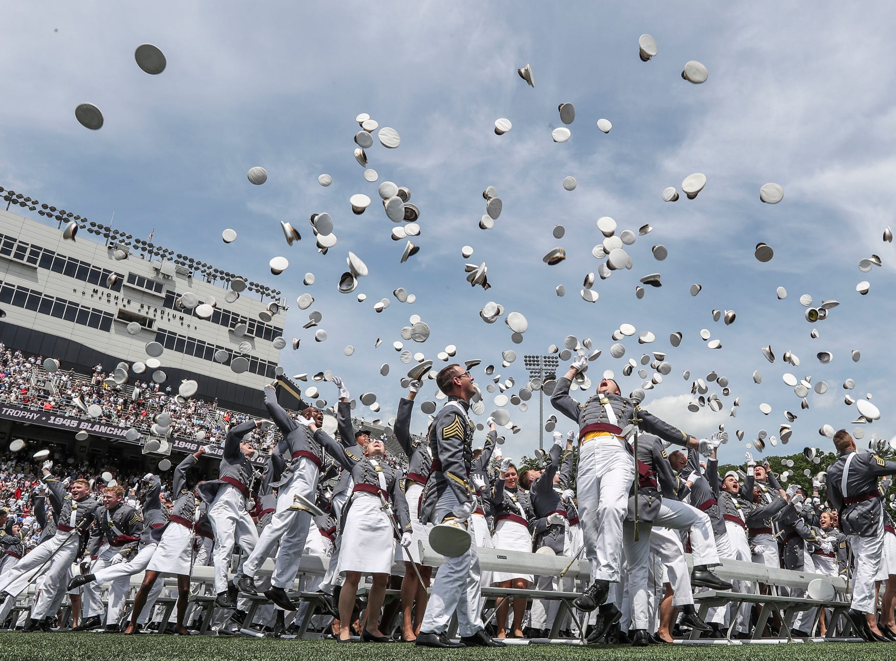 Cadets toss their covers after the 220th graduation and commissioning ceremony at U.S. Military Academy at West Point on Saturday, May 26, 2018.