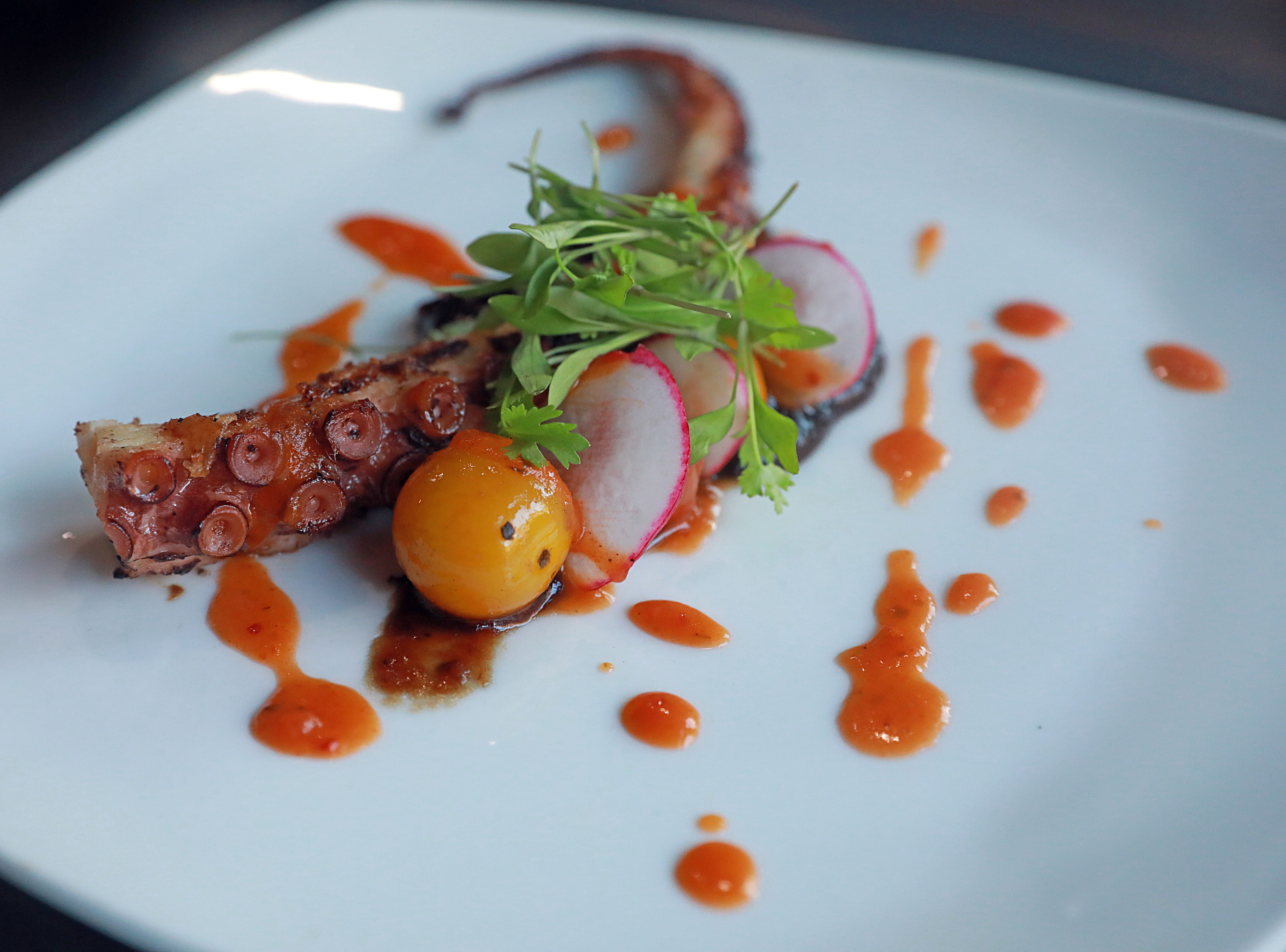 CARUCHA L. MEUSE: Pulpo a la plancha is crisp octopus, burst tomato, balsamic onion jam and red chili salsa is served during dinner with Jeanne at DonJito  in Mamaroneck July 26, 2018.