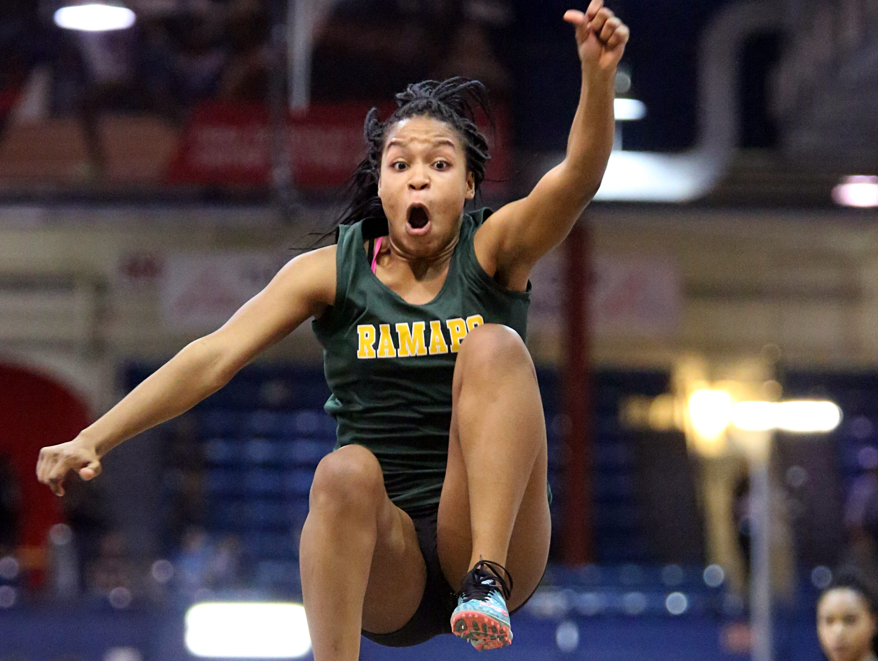 Rampo's Wilkilandjie Marseille competes in the long jump during Section 1 State Track and Field Qualifier at The Armory in Manhattan Feb. 21, 2018.
