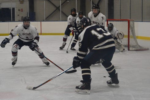 Josh Cohen looks for an open Wildcats teammate on Wednesday against Harvey.