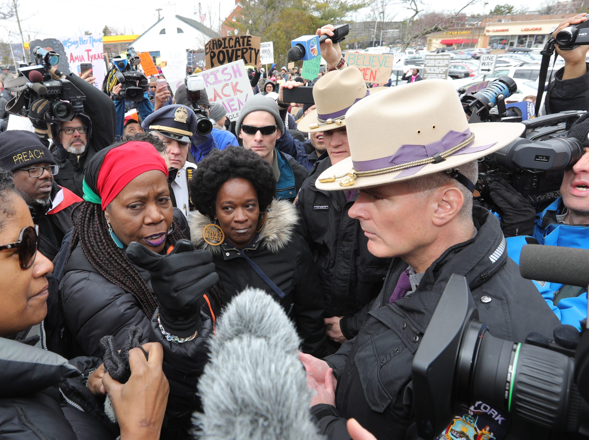 Black Women's March organizer Vanessa Green, left, explains to Capt. George Mohl of the New York State Police, the protesters plan on marching across the Gov. Mario M. Cuomo Bridge from Tarrytown to Nyack on Saturday, April 7, 2018.  The protesters were stopped by police. Attempts to cross the police line by protesters causing pushing and shoving between police and protesters. No arrests were made.