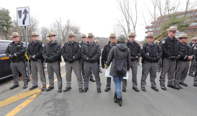 Anna Adler from Cold Spring, center, confronts a line of New York State Police at the Rt. 119 entrance ramp to the NY State Thruway during the Black Women's March in Tarrytown on Saturday, April 7, 2018.  Over one-hundred protestors attempted to enter the New York State Thruway to cross over the bridge, but were stopped by police. Several protestors attempted to cross the police line, causing pushing and shoving between police and protestors. No arrests were made.