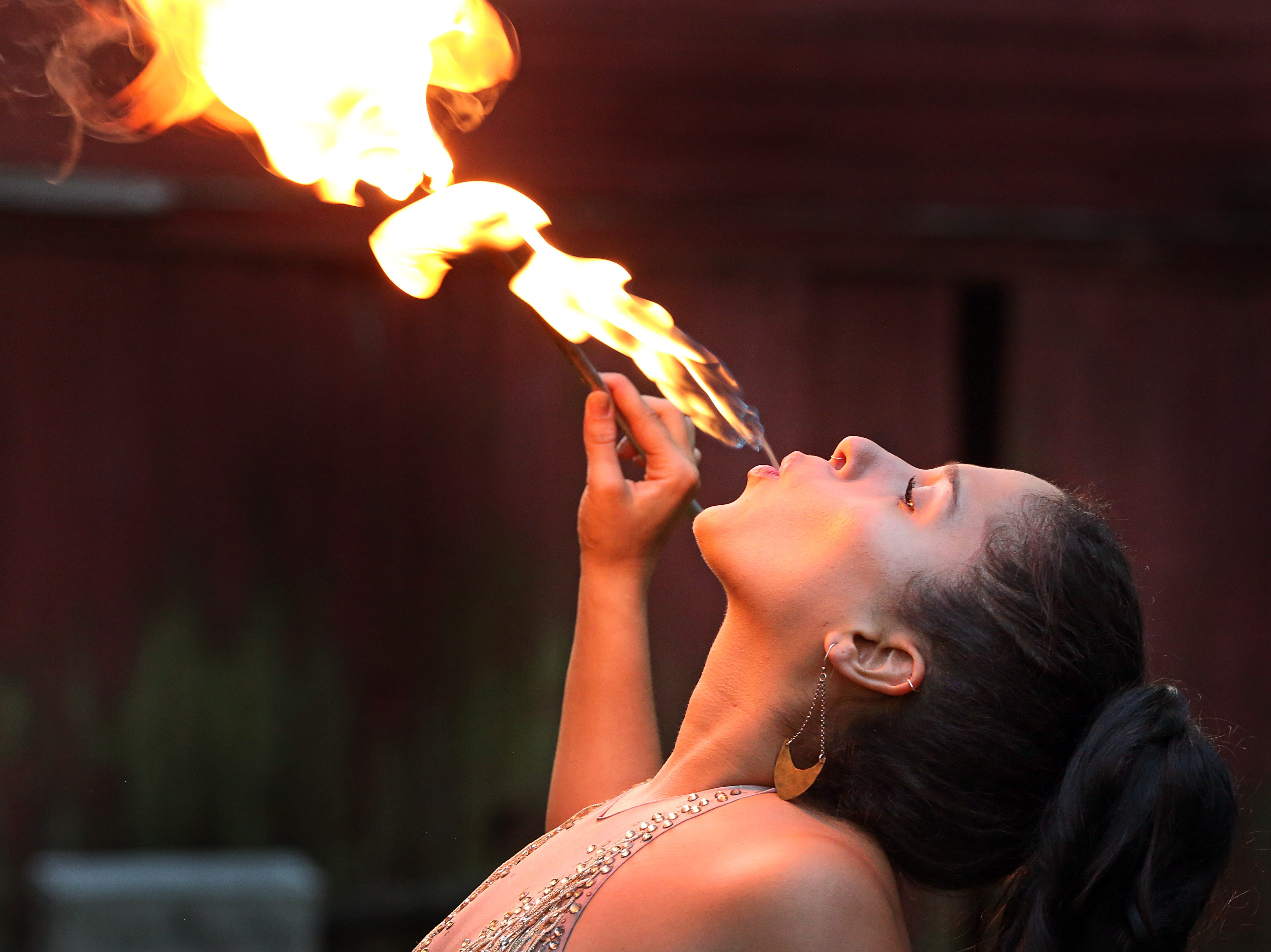 """""""It's special for me to be involved in something that's part of our community,"""" states Brittny Popolizio of Valley Cottage who will be performing at Rockland County Pride Center's gala. Professional hula hoop and fire performer Popolizio shows of her skills at her home in Valley Cottage Oct. 1, 2018."""