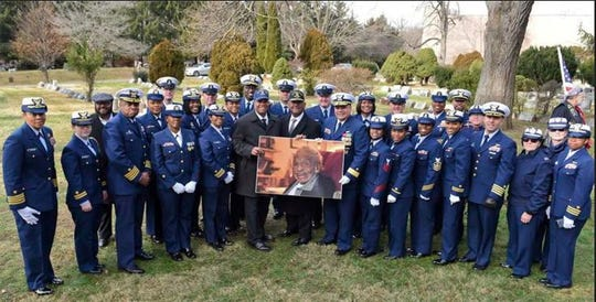 U.S. Coast Guard members past and present from around  the country stand around a photograph of Olivia Hooker during her funeral service held Wednesday, Dec. 5, 2018, in White Plains, New York. Hooker, the first African-American woman to serve in  the U.S. Coast Guard and one of the last survivors of the 1921 Tulsa, Oklahoma, race riot, has been laid to rest with military honors. Hooker, a Greenburgh, New York, resident, died on Nov. 21, 2018,  at the age of 103.