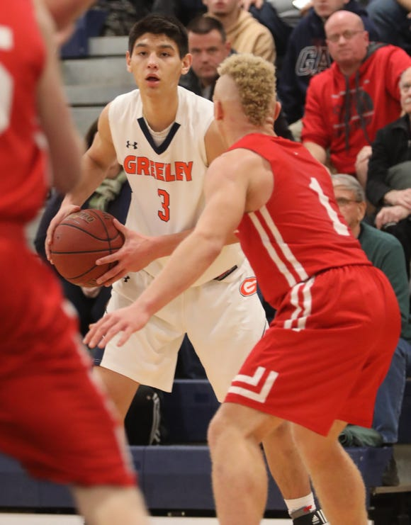 Horace Greeley's Chris Melis (3) looks for an open man during boys basketball game against Tappan Zee at Horace Greeley high school in Chappaqua Dec. 5, 2018.  Tappan Zee beats Horace Greeley 49-46.