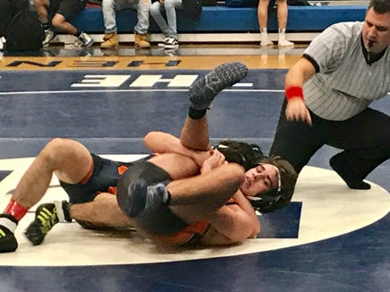 Greeley's Dom Ruggiero (l) pins Mamaroneck's Guy Santee but Mamaroneck advanced to the Section 1 Duel quarters with 53-27 win.