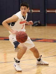 Horace Greeley's Chris Melis (3) steals the ball during boys basketball game at the high school in Chappaqua Dec. 5, 2018. Tappan Zee beats Horace Greeley 49-46.